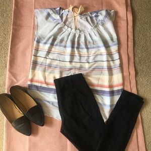 Pastel colored striped blouse.